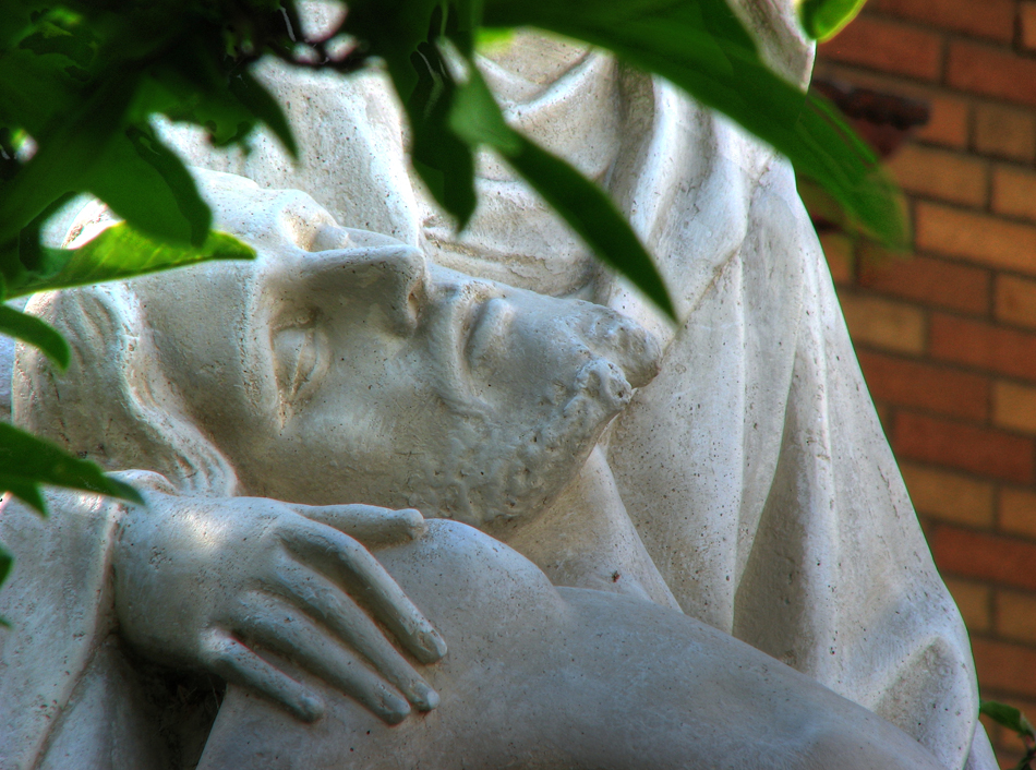 A closeup of Jesus in the statue The Pieta by Michaelangelo outside Our Lady of Sorrows Church in St. Louis, MO