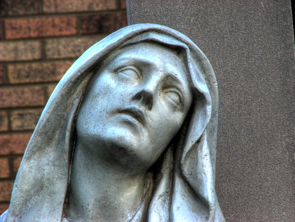 A closeup of the face of Mary in the statue The Pieta by Michaelangelo outside Our Lady of Sorrows Church in St. Louis, MO