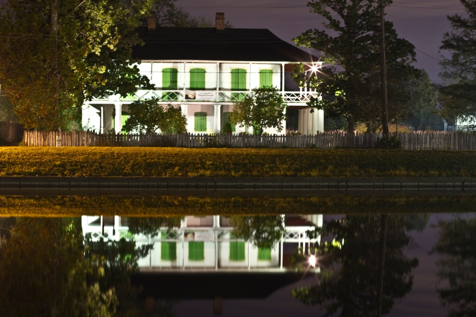 A reflection of a New Orleans home in Bayou St. John Louisiana