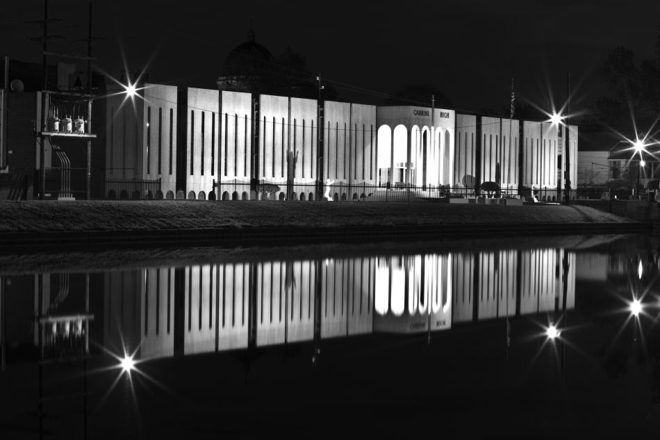 Black & White Picture of Cabrini High School and its reflection in Bayou St. John in New Orleans at night