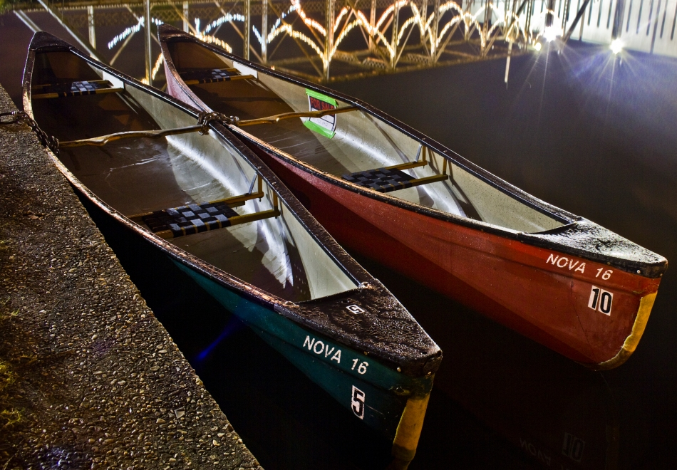 two canoes docked in bayou st. john at night in New Orleans, Louisiana
