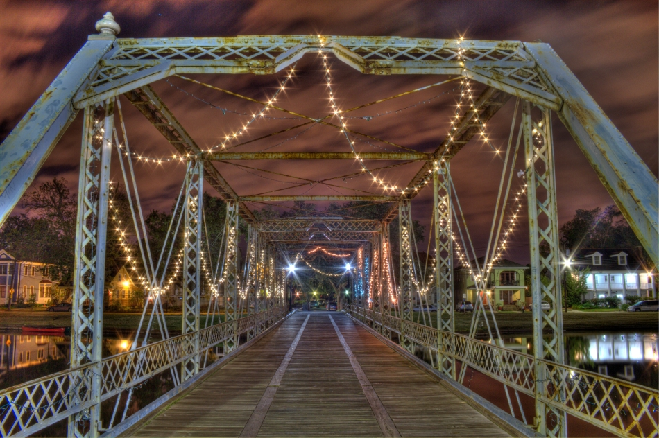 Pedestrian Bridge over Bayou St. John in New Orleans, Louisiana at night in high dynamic range