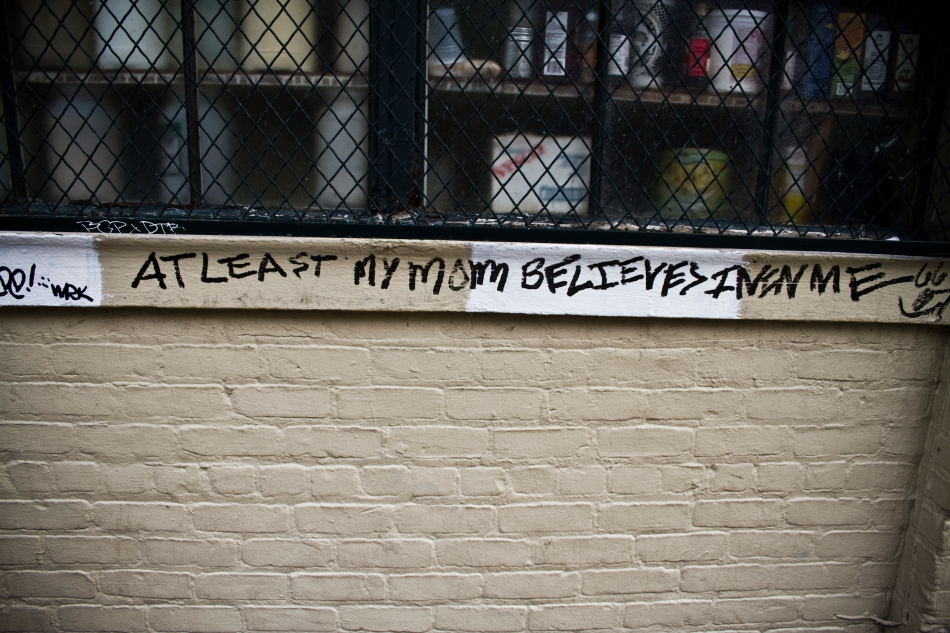 """Graffiti in the French Quarter in New Orleans that reads """"At last my mom believes in me"""""""