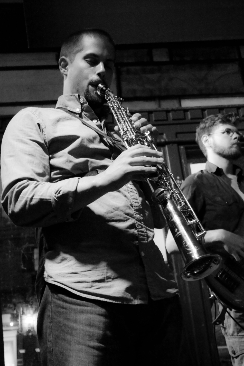 Saxophonist Bryce playing a soprano saxophone with New Orleans Jazz Trio Chicken & Waffles