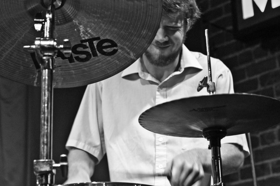 Drummer Joel plays drums with New Orleans jazz trio Chicken & Waffles at Maison on Frenchmen Street in New Orleans, Louisiana