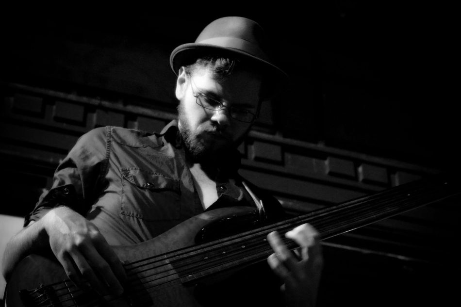 Bassist Stephen plays with New Orleans jazz trio Chicken & Waffles at Maison on Frenchmen in New Orleans, Louisiana