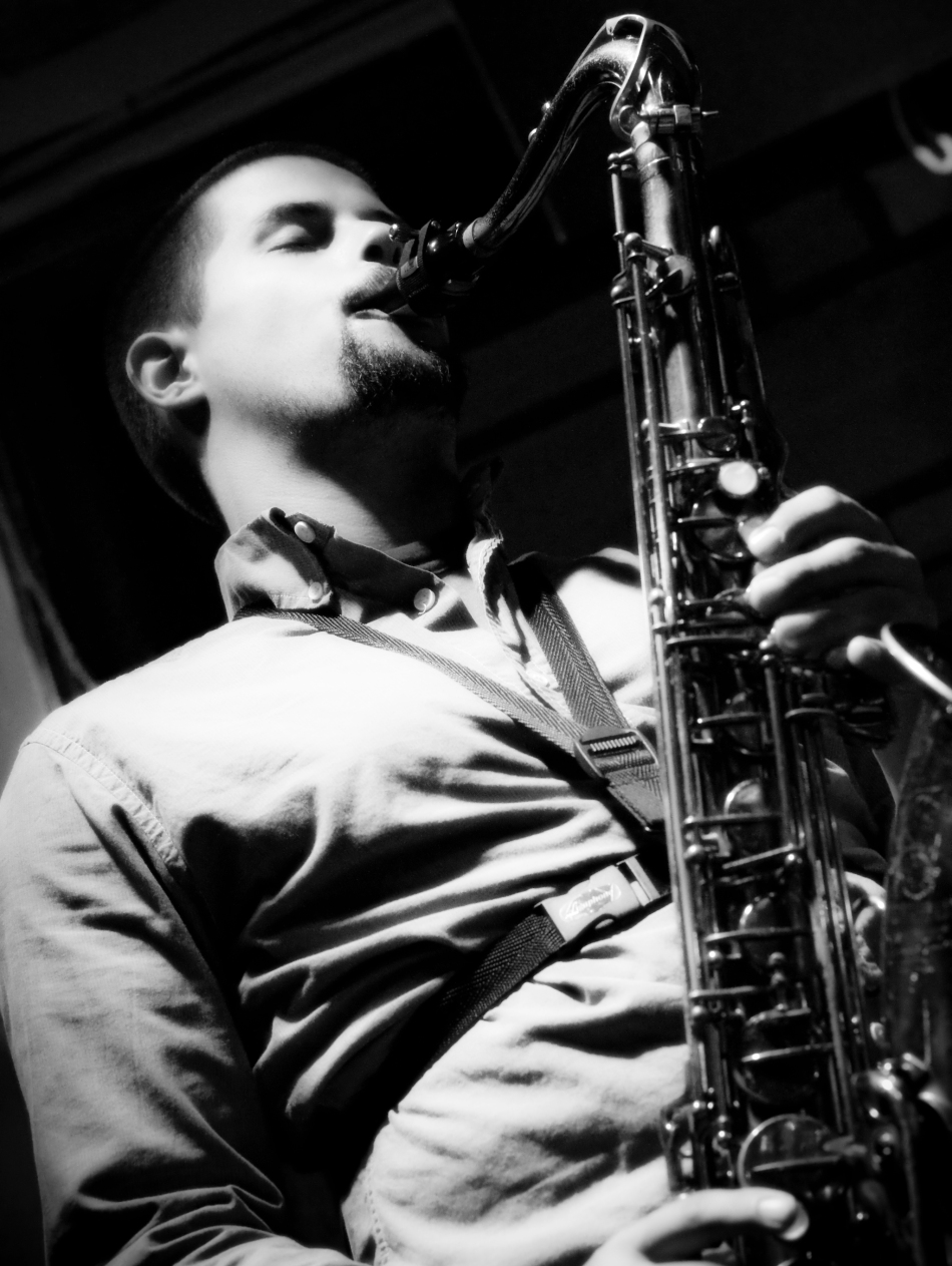 Saxophonist Bryce plays with New Orleans jazz trio Chicken & Waffles at Maison on Frenchmen in New Orleans, LA