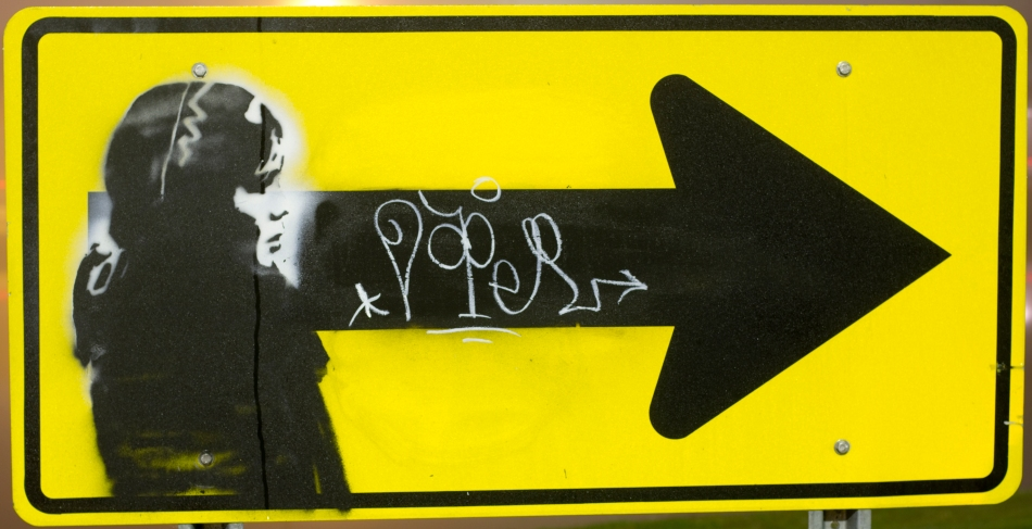 Graffiti of a woman on a traffic sign signed by the Graffiti artist named Doper