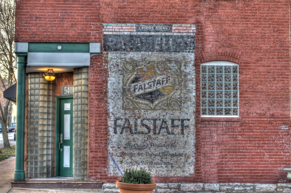 A sign depicting the Falstaff Beer logo painted on the side of a brick building in St. Louis, MO