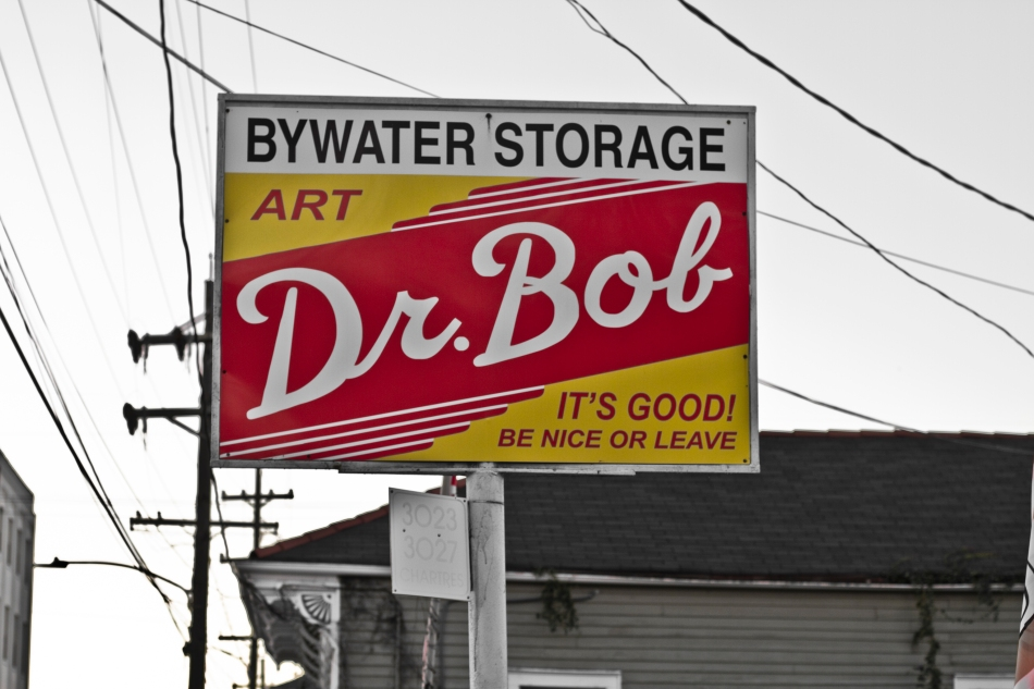 A sign in the Bywater that reads Bywater Storage Art It's Good Dr. Bob Ne Nice Or Leave