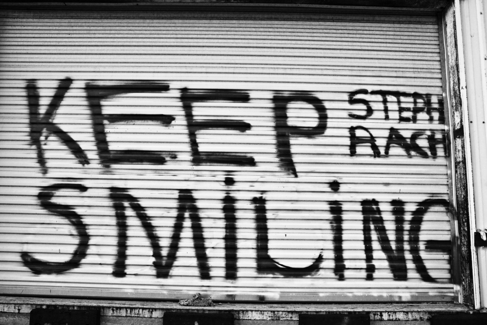 Graffiti in the Bywater of New Orleans, LA reading Keep Smiling