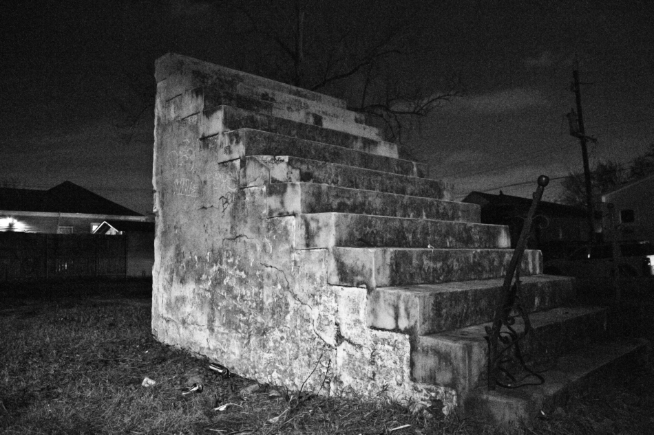 A set of freestanding stairs standing next to an empty plot of land in New Orleans, LA