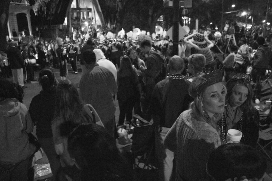A crowd of people at a Mardi Gras parade in New Orleans, LA in 2013.