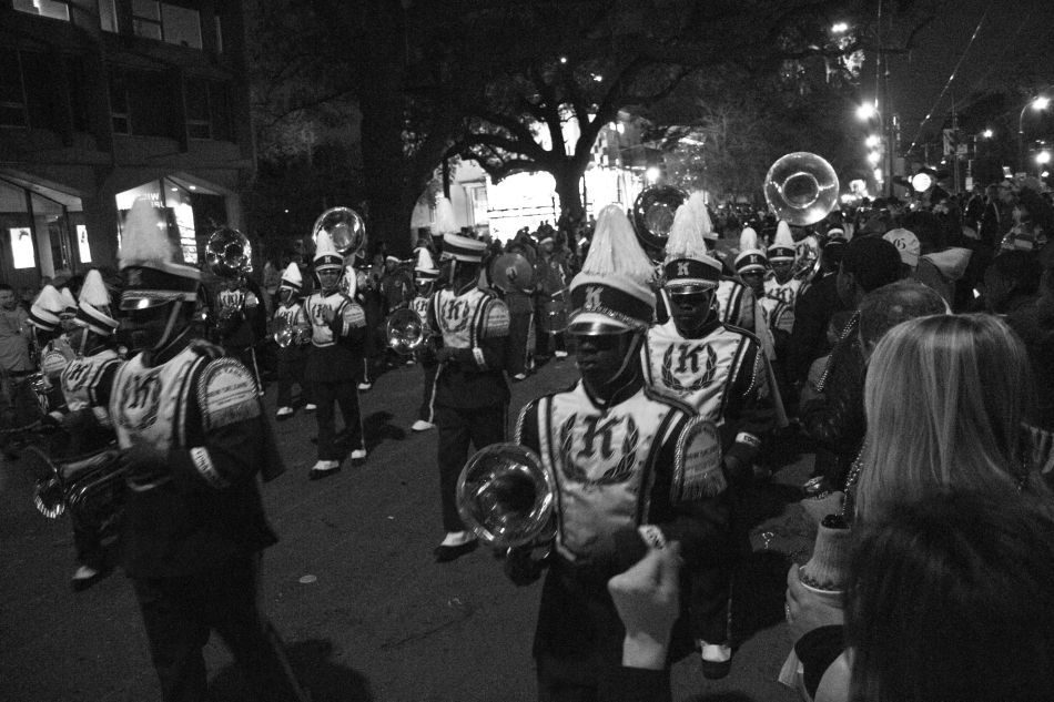 A marching Band marches in the Krewe D'Etat Mardi Gras parade in New Orleans, LA on february 8, 2013