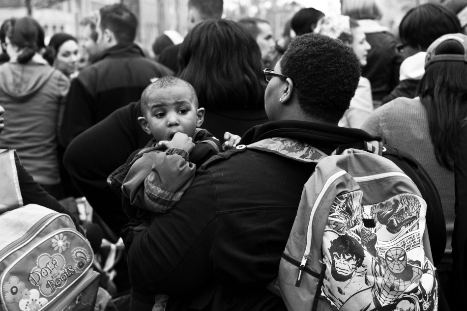 A baby and his mother at the Endymion Mardi Gras parade in New Orleans, LA on February 9, 2013