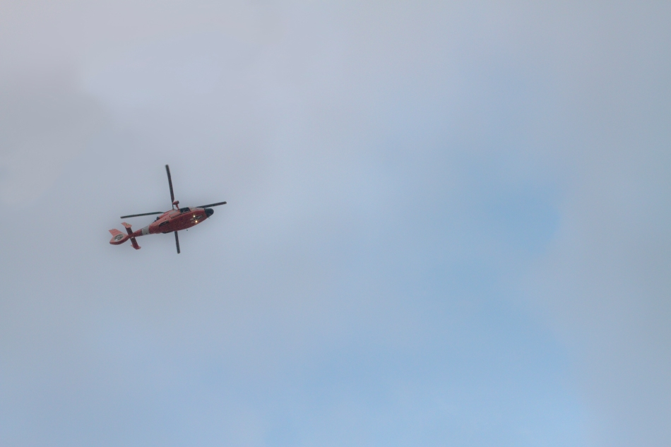 A helicopter flies over New Orleans, LA on February 9, 2013