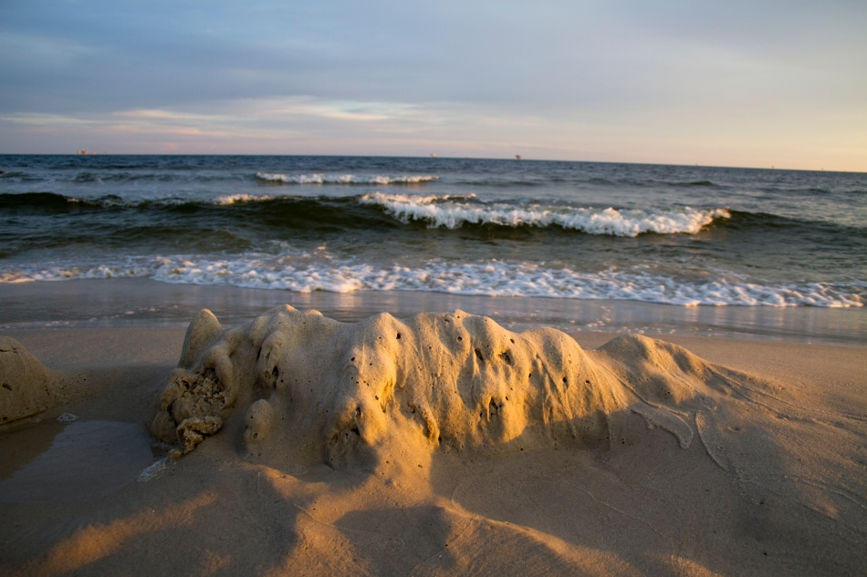 A mound of sand and the gulf of mexico