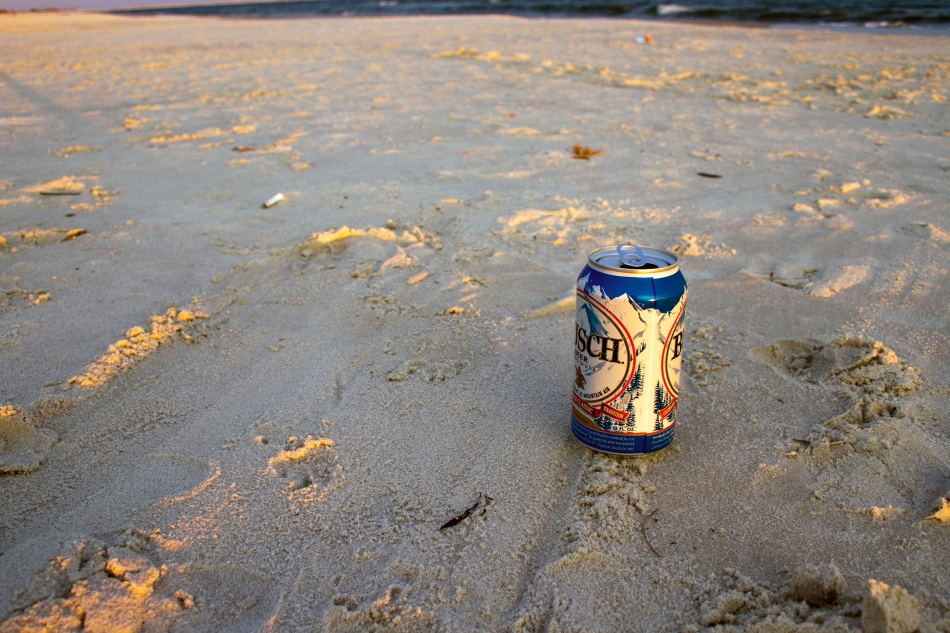 A Busch beer can casting a long shadow on the beach at Dauphin Island, AL