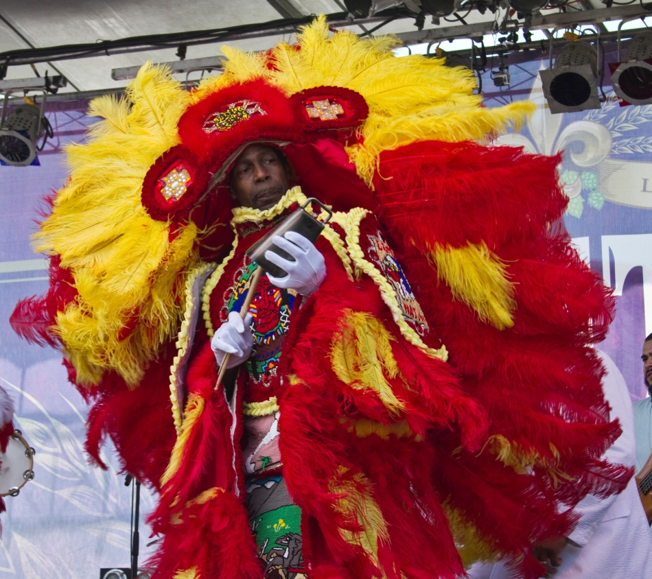 A Mardi Gras Indian from the Guardians of the Flame tribe performs with Donald Harrison, Jr. at French Quarter Fest on April 13, 2013