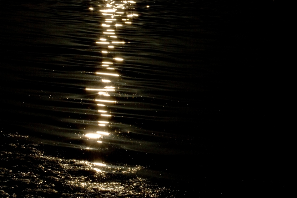 A reflection of sunlight on water.