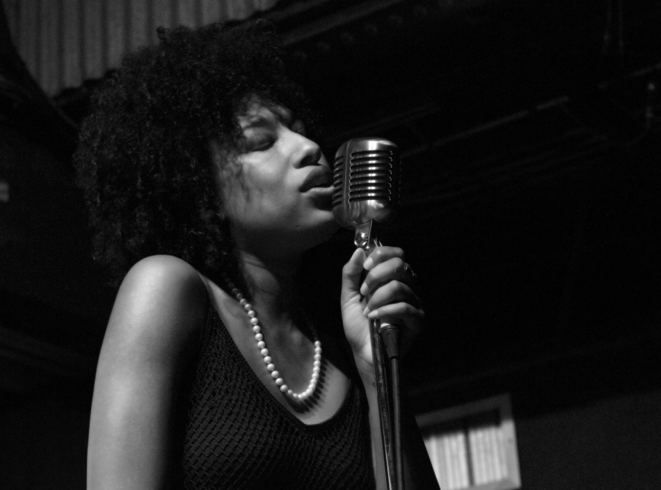 Vocalist Mykia Jovan performs with Kermit Ruffins at Tipitina's Uptown, New Orleans, LA on June 8, 2013.
