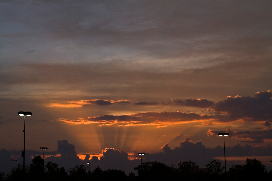 A sunset over a movie theatre parking lot in Elmwood, Louisiana