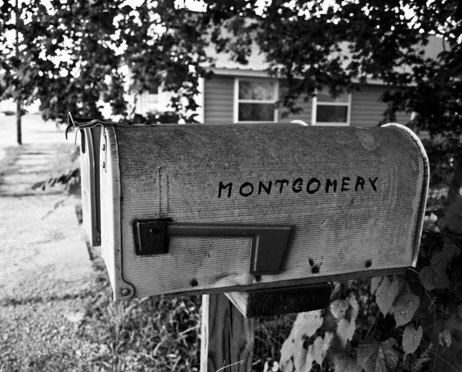 "A mailbox in Ellington, MO with the name ""Montgomery"" painted on it."