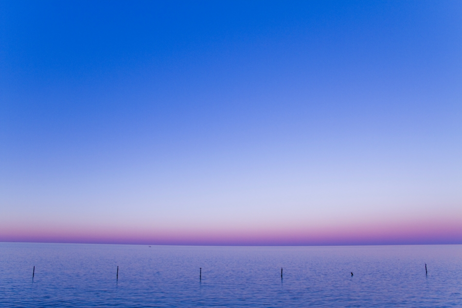 the horizon at sunset on Lake Pontchartrain in New Orleans, LA.
