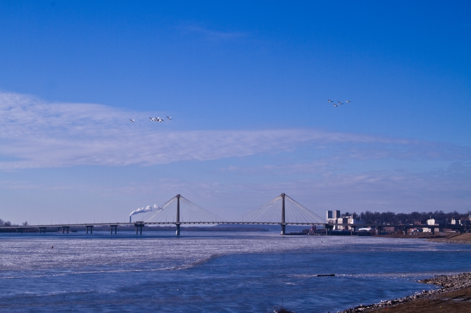 A view of the South side of Alton, Illinois, The Clark Bridge, and the Mississippi River.