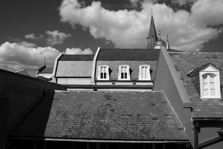 A side view of St. Louis Cathedral in the French Quarter New Orleans, LA as seen from a balcony at Chartres Street and St. Peter Street