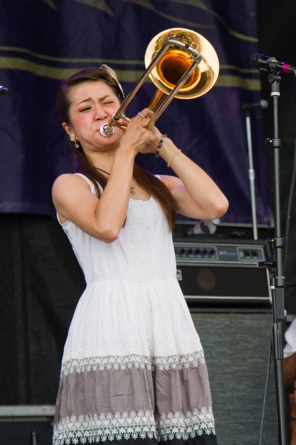 Trombonist Haruka Kikichi performing at French Quarter Fest 2015 in New Orleans, LA. Photo by Braden Piper bgpiperphotography.com