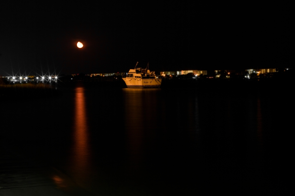 A night shot of a boat anchored in the Gulf of Mexico at Navarre Beach, FL