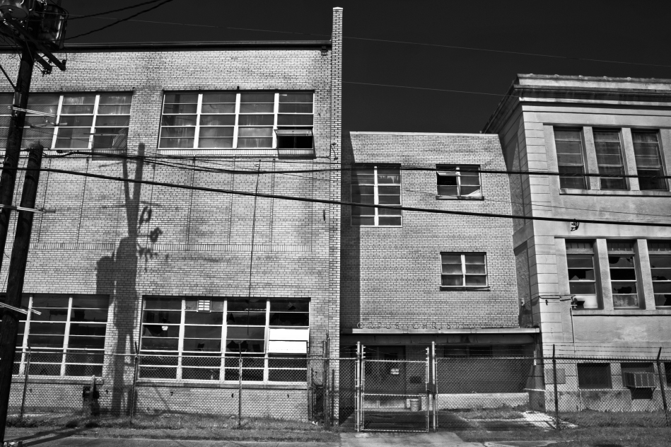 A black and white image of the now closed Corpus Christi school located in the 7th Ward of New Orleans, LA.