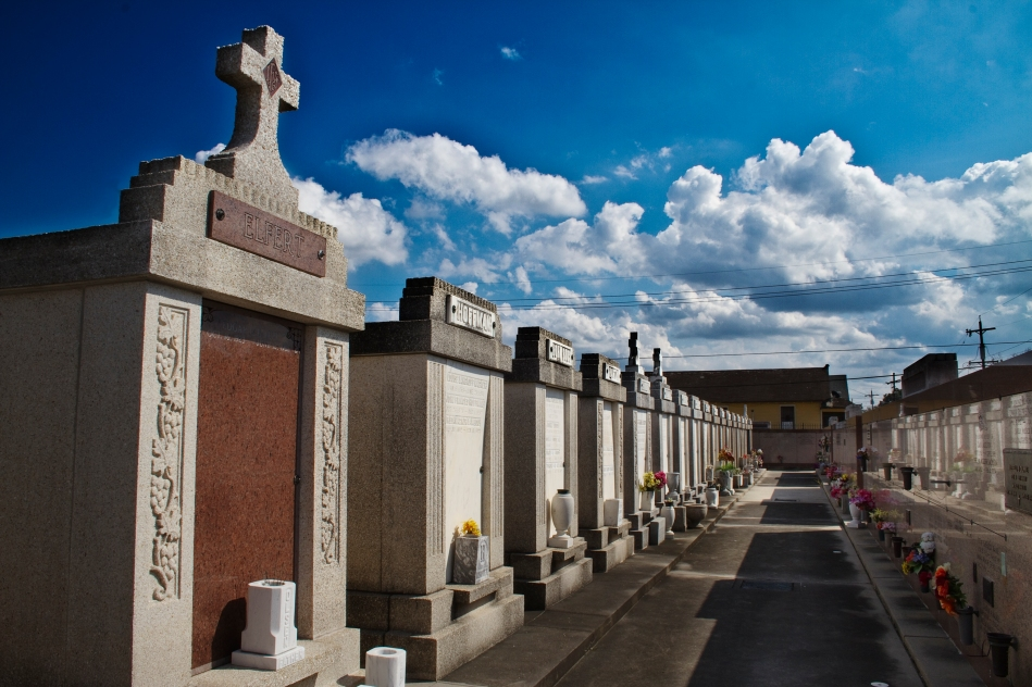 Crypts and a blue cloudy sky at St. Roch Cemetery in New Orleans, LA
