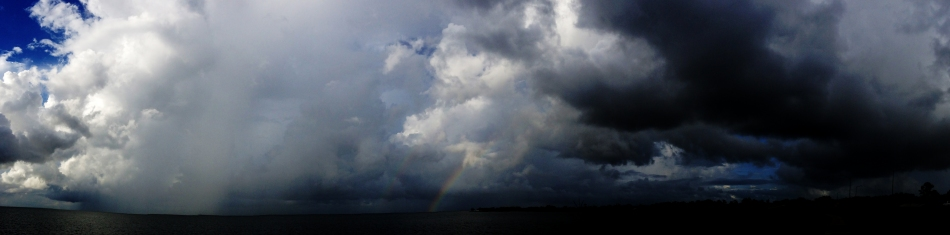 A Double Rainbow appearing in front of dark clouds on Lake Ponchartrain in New Orleans, Louisiana