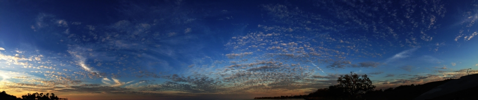 A view of the clouds in the sky justafter sunset on Lake Ponchartrain in New Orleans, LA