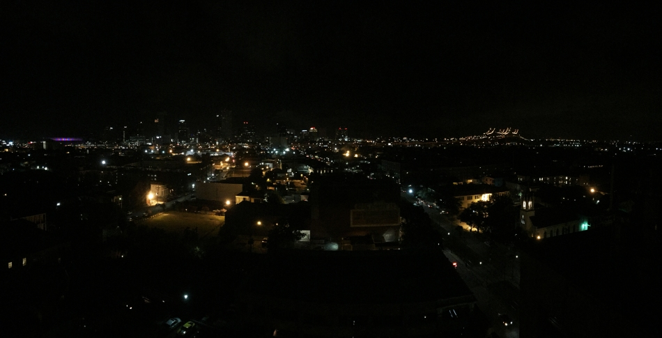 A nighttime panorama of the New orleans skyline taken from on top of the Pontchartrain hotel including the Mercedes Benz Superdome and The Crescent City Connection